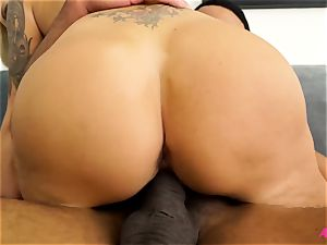 big-boobed blonde Nina Elle taking a large ebony cock
