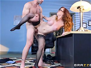 Dani Jensen playing with pipe in the office
