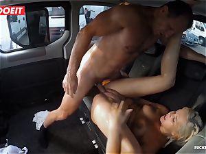 blonde hottie unloads all over the backseat of a van