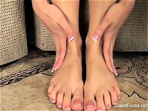 spectacular Capri Cavanni plays with her cute soles