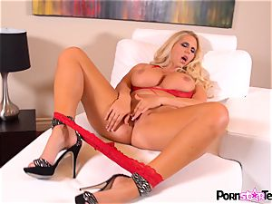 blonde beauty Karen Fisher plays with her killer minge