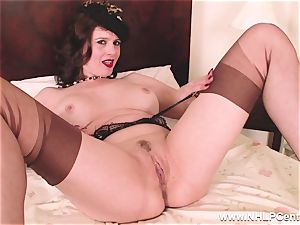 scorching milf dildos toy to climax in stockings suspenders